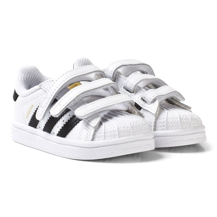 f7bf4007a1ab adidas Originals. White and Black Superstar Infant Trainers